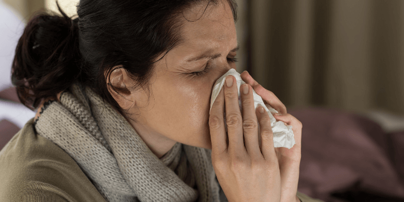 women sneezing