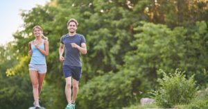 man and woman jogging outside for new years resolution